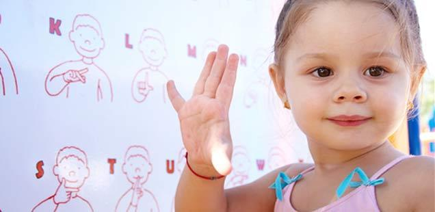 Little-girl-using-sign-language.jpg#asset:2827